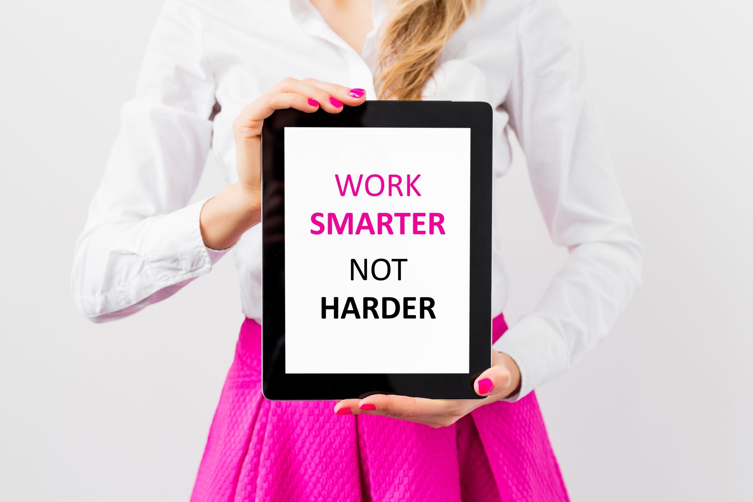 Image is of a woman holding a ablet saying work smarter not harder
